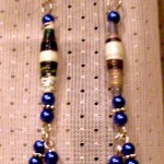 These Mushana beads were made with rolled up newspaper. Pearls and silver accents round it out.